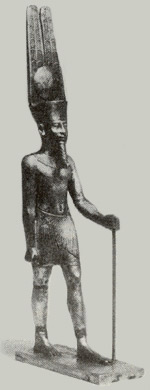Statue of Amon with crown of sun disk and plumes.