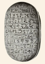 The underside of a heart scarab from the New Kingdom.